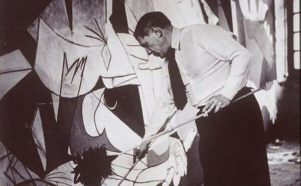 Pablo Picasso painting Guernica in his studio, Paris, 1937